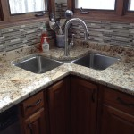 granite countertop with custom tile backsplash