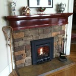 Custom gas fireplace with handcrafted mantle