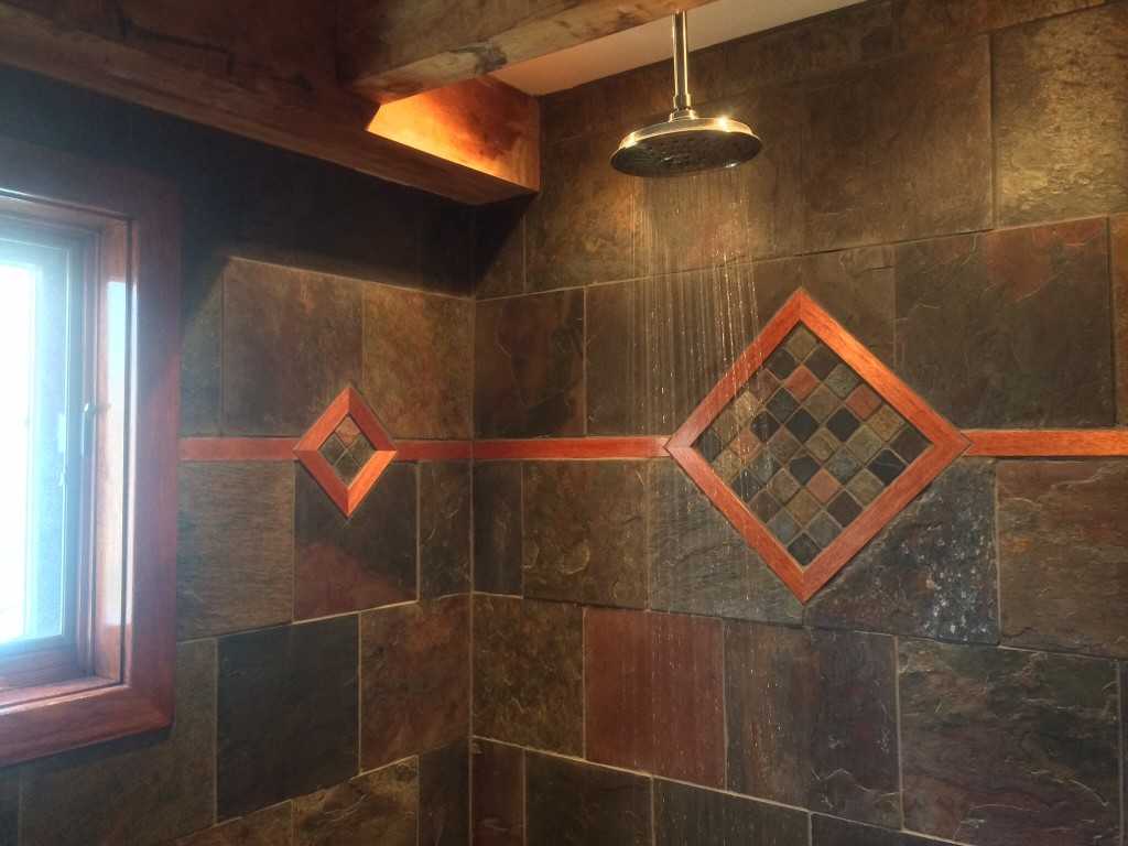 Inlayed wood in slate shower